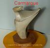 Sculpture abstraite en st�atite, de couleur gris clair, nomm�e `Carmargue`, car avec un peu d`imagination , on peut y voir des cornes et une t�te de taureau.